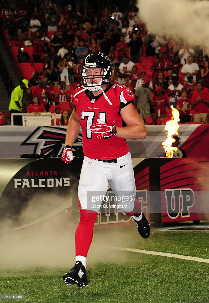 Kroy Biermann of the Atlanta Falcons is introduced before a preseason game against the Tennessee Titans at the Georgia Dome on August 23 2014 in...