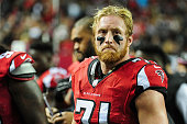 Kroy Biermann of the Atlanta Falcons reacts on the sidelines in the first half against the Carolina Panthers at the Georgia Dome on December 28 2014...