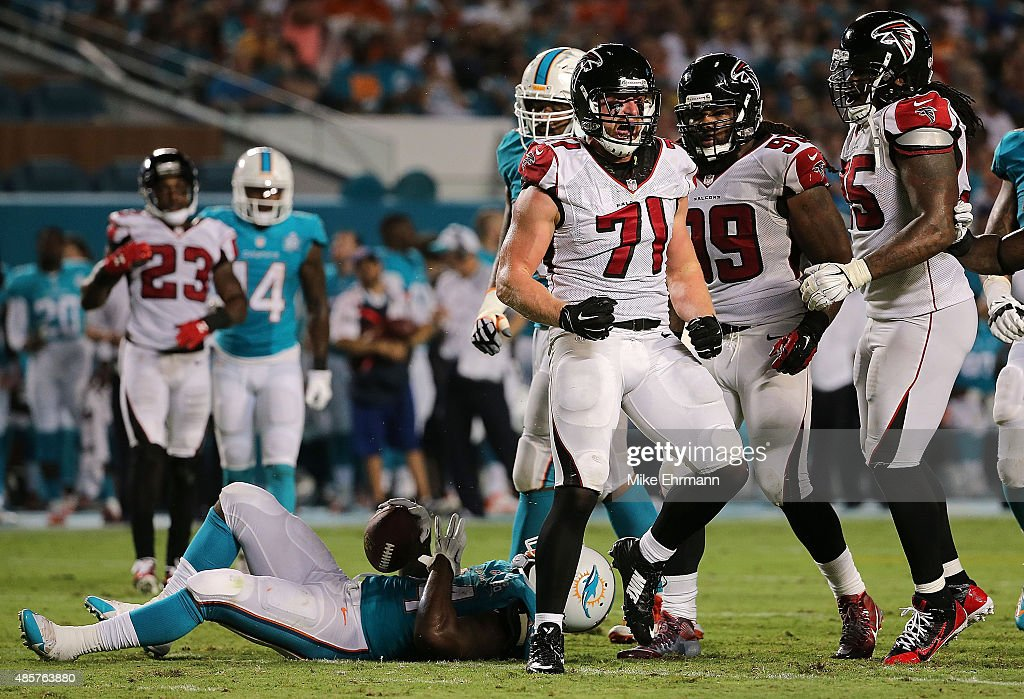 <a gi-track='captionPersonalityLinkClicked' href=/galleries/search?phrase=Kroy+Biermann&family=editorial&specificpeople=5085129 ng-click='$event.stopPropagation()'>Kroy Biermann</a> #71 of the Atlanta Falcons reacts to a tackle during a preseason game against the Miami Dolphins at Sun Life Stadium on August 29, 2015 in Miami Gardens, Florida.