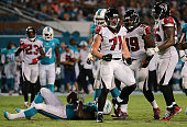 Kroy Biermann of the Atlanta Falcons reacts to a tackle during a preseason game against the Miami Dolphins at Sun Life Stadium on August 29 2015 in...