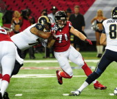 Kroy Biermann of the Atlanta Falcons rushes the passer against the St Louis Rams at the Georgia Dome on September 15 2013 in Atlanta Georgia