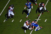 Kroy Biermann of the Atlanta Falcons sacks Eli Manning of the New York Giants during a game at MetLife Stadium on September 20 2015 in East...