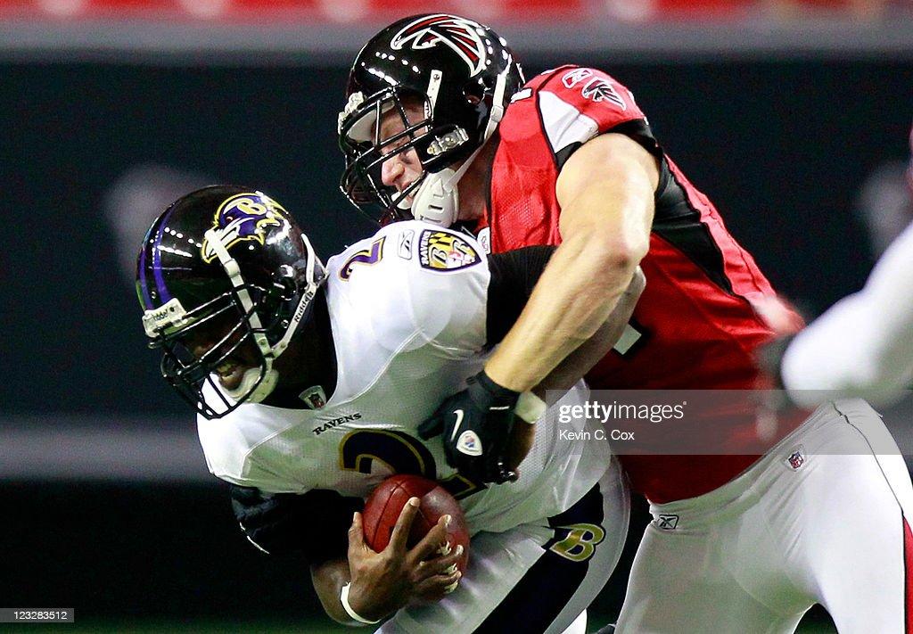 Kroy Biermann #71 of the Atlanta Falcons sacks Tyrod Taylor #2 of the Baltimore Ravens at Georgia Dome on September 1, 2011 in Atlanta, Georgia.