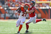 Kroy Biermann of the Atlanta Falcons tackles Giovani Bernard of the Cincinnati Bengals during the first quarter at Paul Brown Stadium on September 14...