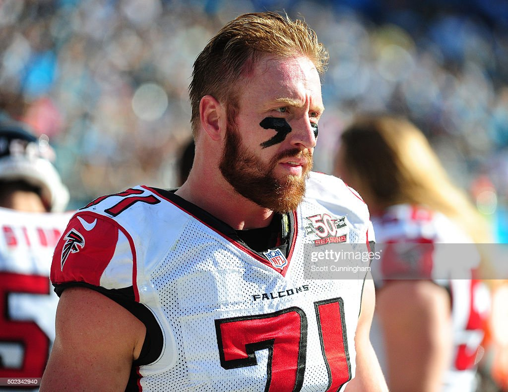 Kroy Biermann of the Atlanta Falcons watches the action against the Carolina Panthers at Bank Of America Stadium on December 13 2015 in Charlotte...