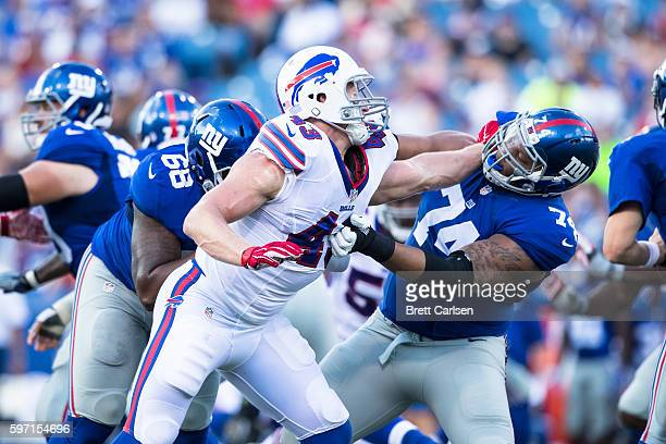 Kroy Biermann of the Buffalo Bills tries to push past Ereck Flowers of the New York Giants during the game on August 20 2016 at New Era Field in...