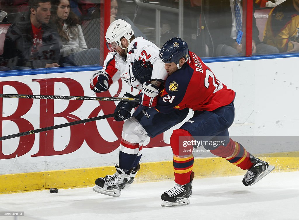 <a gi-track='captionPersonalityLinkClicked' href=/galleries/search?phrase=Krys+Barch&family=editorial&specificpeople=2538220 ng-click='$event.stopPropagation()'>Krys Barch</a> #21 of the Florida Panthers and Mike Green #52 of the Washington Capitals battle for control of the puck at the BB&T Center on December 13, 2013 in Sunrise, Florida. The Panthers defeated the Capitals 3-2 in a shootout.