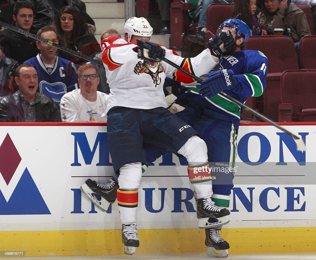 Krys Barch #21 of the Florida Panthers and Ryan Stanton #18 of the Vancouver Canucks collide during their NHL game at Rogers Arena on November 19, 2013 in Vancouver, British Columbia, Canada.