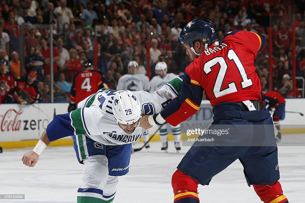 Krys Barch of the Florida Panthers and Tom Sestito of the Vancouver Canucks fight during first period action at the BBT Center on March 16 2014 in...