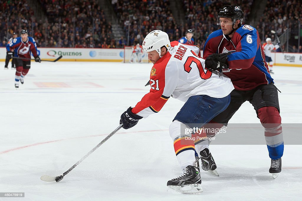 <a gi-track='captionPersonalityLinkClicked' href=/galleries/search?phrase=Krys+Barch&family=editorial&specificpeople=2538220 ng-click='$event.stopPropagation()'>Krys Barch</a> #21 of the Florida Panthers controls the puck against <a gi-track='captionPersonalityLinkClicked' href=/galleries/search?phrase=Erik+Johnson+-+Ice+Hockey+Player&family=editorial&specificpeople=457696 ng-click='$event.stopPropagation()'>Erik Johnson</a> #6 of the Colorado Avalanche at Pepsi Center on November 16, 2013 in Denver, Colorado. The Panthers defeated the Avalanche 4-1.