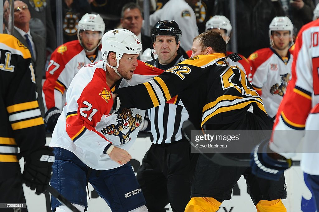 Krys Barch of the Florida Panthers fights against Shawn Thornton of the Boston Bruins at the TD Garden on March 4 2014 in Boston Massachusetts
