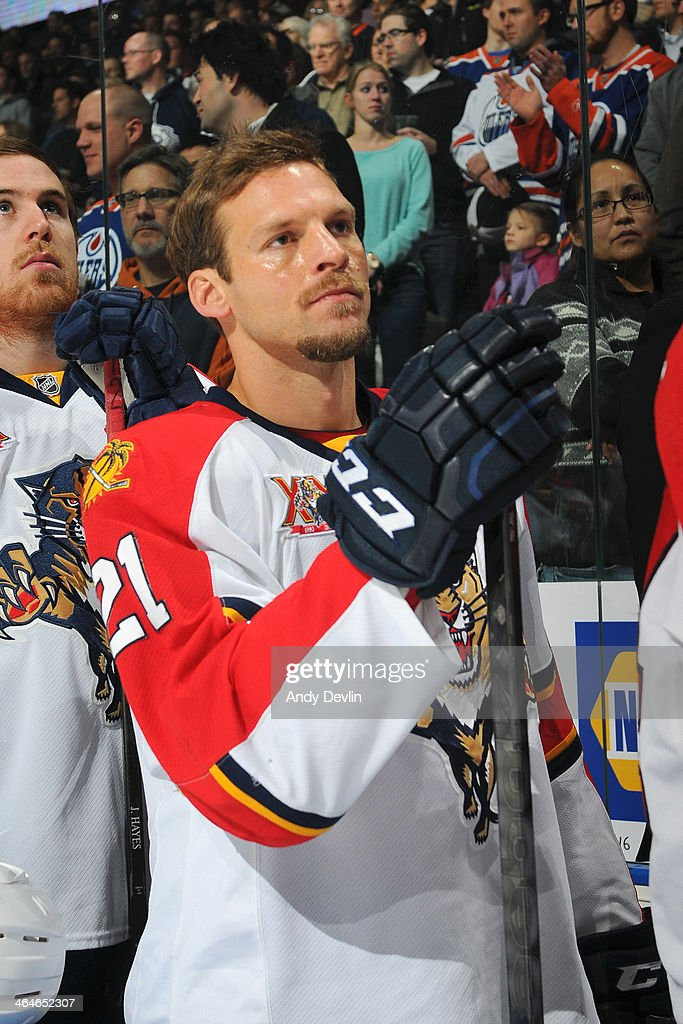 Krys Barch of the Florida Panthers stands for the singing of the national anthem prior to a game against the Edmonton Oilers on November 21 2013 at...