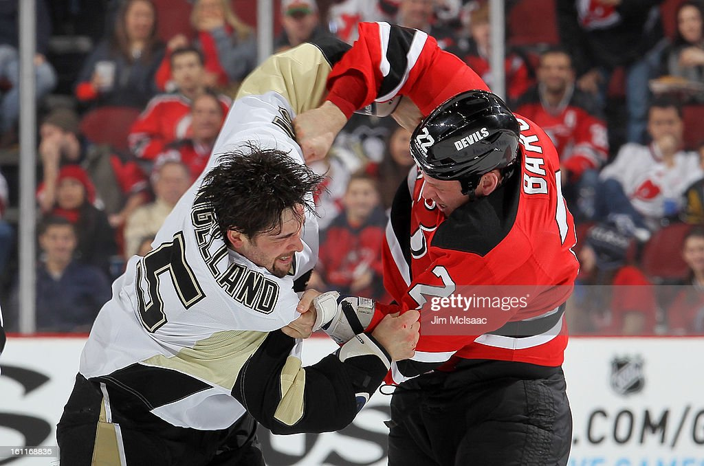 Krys Barch #22 of the New Jersey Devils and <a gi-track='captionPersonalityLinkClicked' href=/galleries/search?phrase=Deryk+Engelland&family=editorial&specificpeople=3390067 ng-click='$event.stopPropagation()'>Deryk Engelland</a> #5 of the Pittsburgh Penguins trade punches during their first period fight at the Prudential Center on February 9, 2013 in Newark, New Jersey.