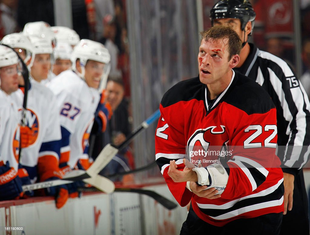 Krys Barch #22 of the New Jersey Devils leaves the ice following his second fight against Brett Gallant #59 of the New York Islanders in the first period at the Prudential Center on September 19, 2013 in Newark, New Jersey.