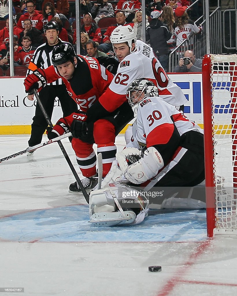 Krys Barch #22 of the New Jersey Devils misses the net against Ben Bishop #30 of the Ottawa Senators at the Prudential Center on February 18, 2013 in Newark, New Jersey.