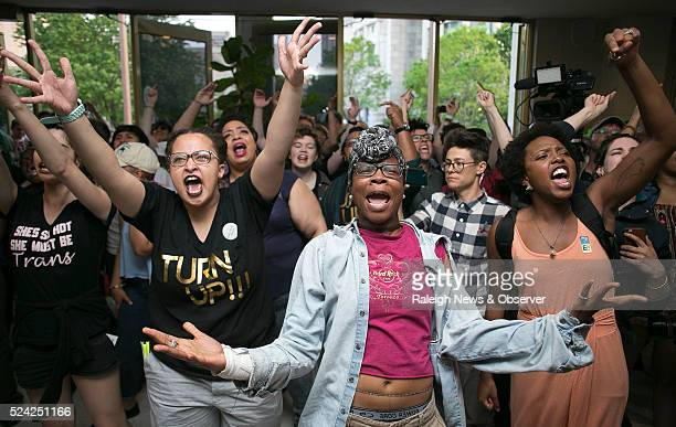 Krys Didtrey left and Gloria Merriweather center of Charlotte NC lead chants in opposition to HB2 during a protest in the lobby of the State...