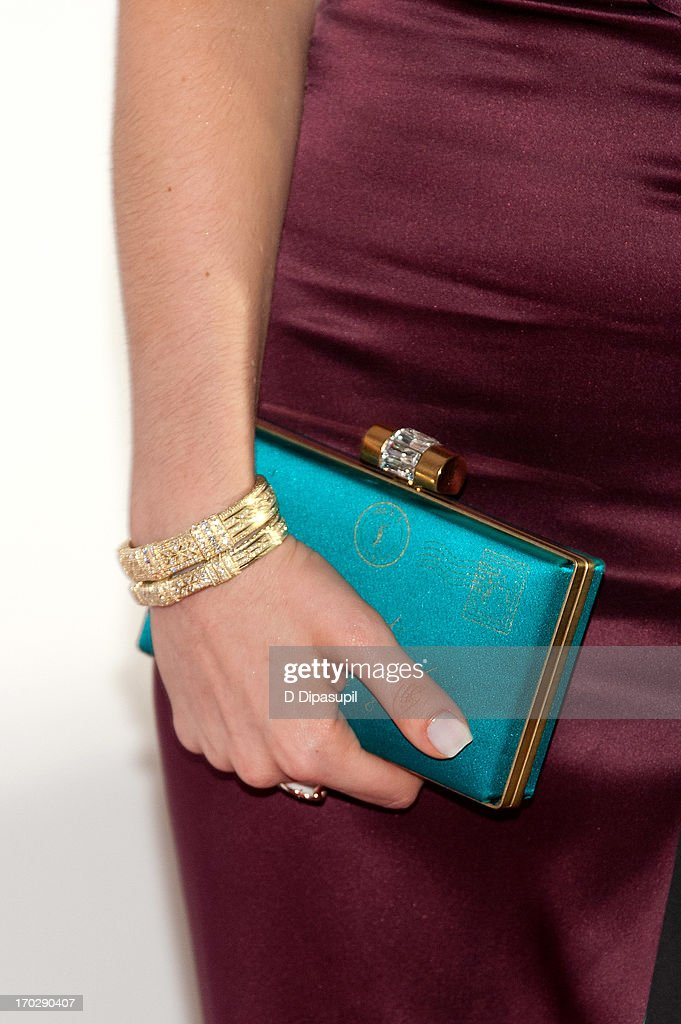 Krysta Rodriguez (clutch/bracelet detail) attends the 67th Annual Tony Awards at Radio City Music Hall on June 9, 2013 in New York City.