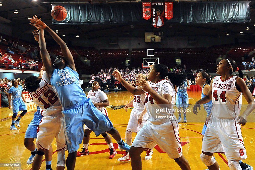 Krystal Barrett #12 of the North Carolina State Wolfpack and Waltiea Rolle #32 of the North Carolina Tar Heels battle for a rebound at Reynolds Coliseum on January 10, 2013 in Raleigh, North Carolina.