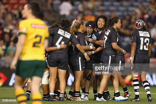 Krystal Rota of the Kiwi Ferns celebrates with his team mates after scoring a try during the Women's international Rugby League Test match between...