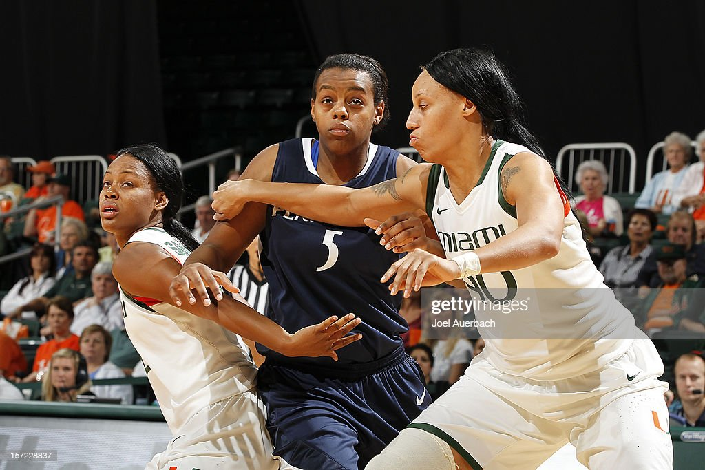 Krystal Saunders #12 and Shawnice Wilson #40 of the Miami Hurricanes box out Talia East #5 of the Penn State Lady Lions on November 29, 2012 at the BankUnited Center in Coral Gables, Florida. Miami defeated Penn State 69-65.