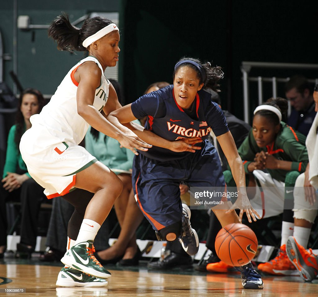 Krystal Saunders #12 of the Miami Hurricanes defends against Ataira Franklin #23 of the Virginia Cavaliers on January 6, 2013 at the BankUnited Center in Coral Gables, Florida.
