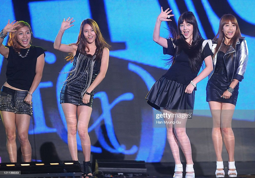 Krystal (2nd L), Sulli (2nd R) and Victoria (R) of F(x) perform onstage during the Incheon Korean Wave Festival 2011 at Incheon World Cup Stadium on August 13, 2011 in Incheon, South Korea.