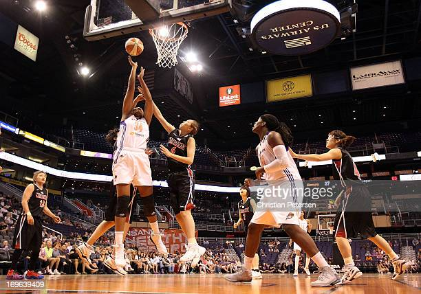 Krystal Thomas of the Phoenix Mercury attempts a shot during the preseason WNBA game against Japan at US Airways Center on May 19 2013 in Phoenix...