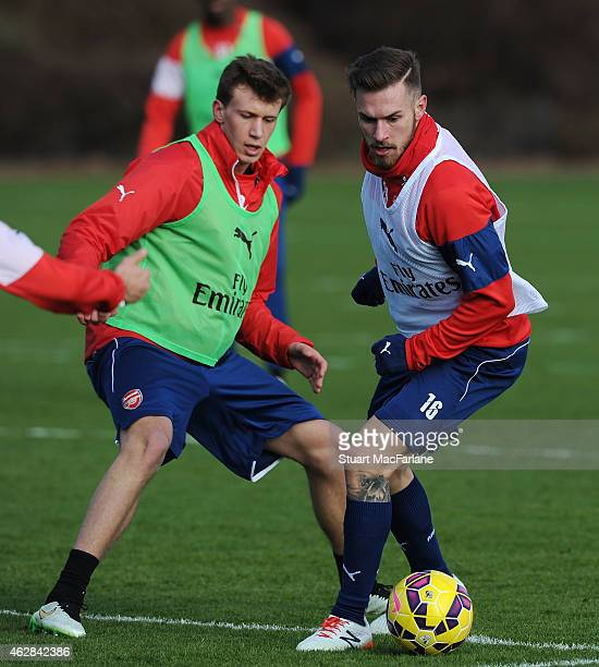 Krystian Bielik and Aaron Ramsey of Arsenal during a training session at London Colney on February 6 2015 in St Albans England