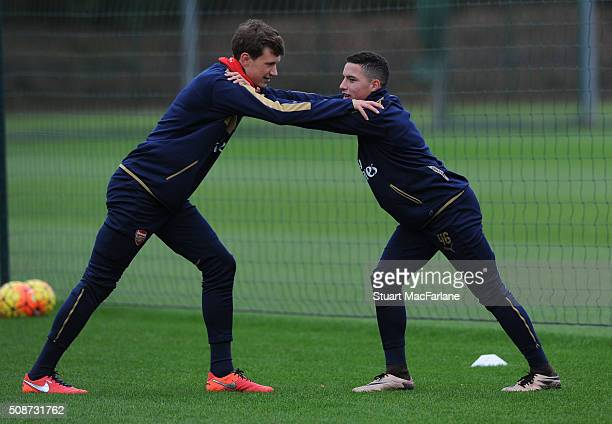 Krystian Bielik and Ismael Bennacer of Arsenal during a training session at London Colney on February 6 2016 in St Albans England