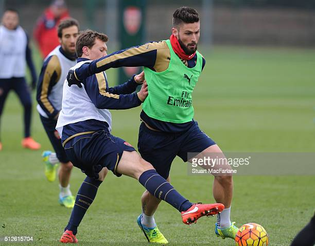Krystian Bielik and Olivier Giroud of Arsenal during a training session at London Colney on February 27 2016 in St Albans England