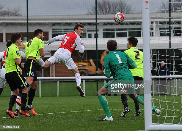 Krystian Bielik heads Arsenal's 2nd goal past Christian Walton of Brighton during the match between Arsenal U21 and Brighton Hove Albion U21 at...