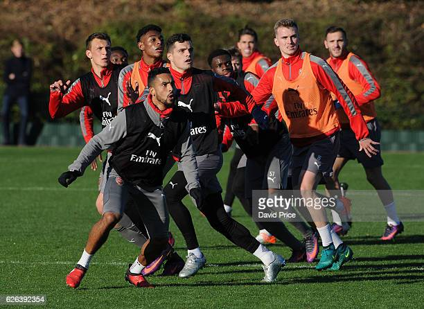 Krystian Bielik Jeff ReineAdelaide Theo Walcott and Granit Xhaka of Arsenal during Arsenal Training Session at London Colney on November 29 2016 in...