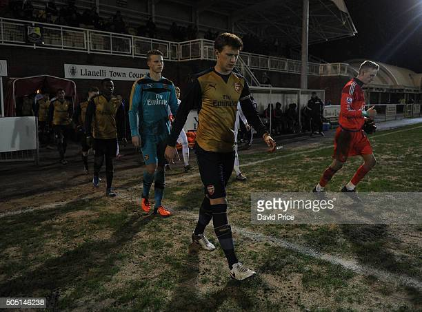 Krystian Bielik leads out the Arsenal team before the match between Swansea U18 and Arsenal U18 at Stebonheath Park on January 15 2016 in Llanelli...