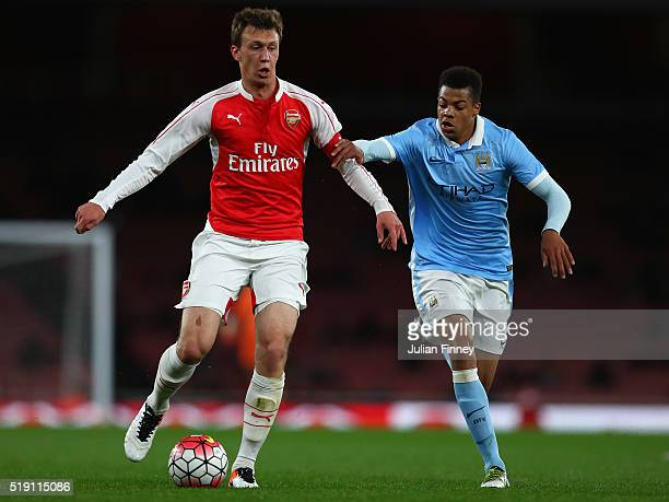 Krystian Bielik of Arsenal battles with Lukas Nmecha of Man City during the FA Youth Cup semifinal second leg match between Arsenal and Manchester...