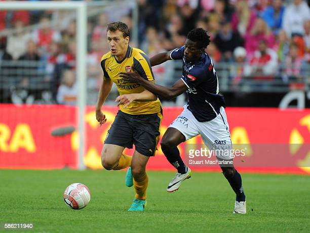 Krystian Bielik of Arsenal breaks past Usman Sale of Viking during the pre season friendly between Viking FK and Arsenal at Viking Stadion on August...