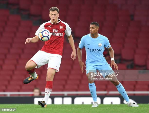 Krystian Bielik of Arsenal challenged by Lukas Nmecha of Man City during the Premier League 2 match between Arsenal and Manchester City at Emirates...