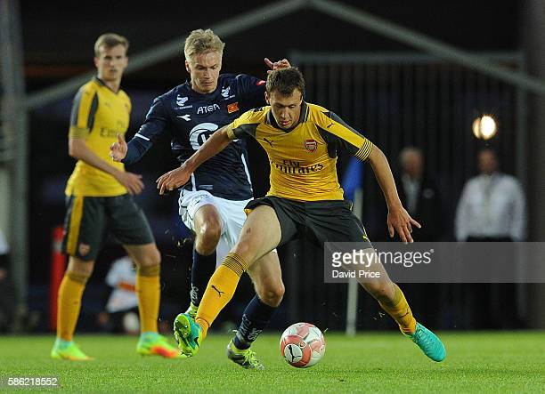 Krystian Bielik of Arsenal holds of Patrick Pedersen of Viking during the match between Viking FK and Arsenal at Viking Stadion on August 5 2016 in...