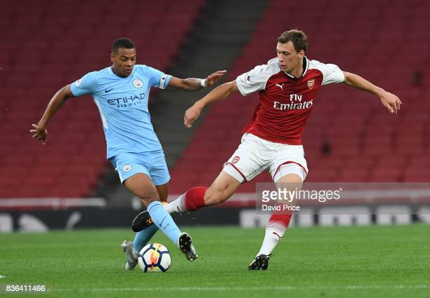 Krystian Bielik of Arsenal is challenged by Lukas Nmecha of Man City during the match between Arsenal U23 and Manchester City U23 at Emirates Stadium...