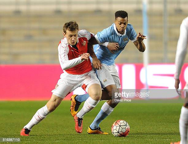 Krystian Bielik of Arsenal is challenged Lukas Nmecha of Man City during the match between Manchester City and Arsenal in the FA Youth Cup semi final...