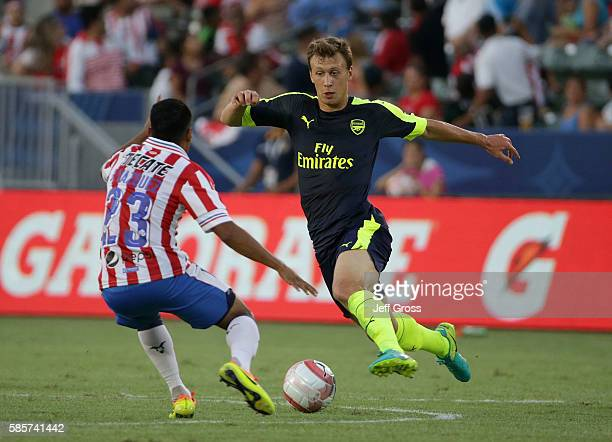 Krystian Bielik of Arsenal is defended by Jose Vazquez of Chivas de Guadalajara at StubHub Center on July 31 2016 in Carson California