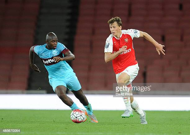 Krystian Bielik of Arsenal races away from Jordan Brown of West Ham during the match between Arsenal U21 and West Ham United U21 at Emirates Stadium...