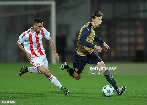 Krystian Bielik of Arsenal races away from Laci Qazim of Olympiacos during the match between Olympiacos and Arsenal on December 9 2015 in Piraeus...