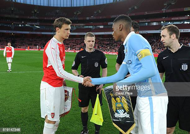 Krystian Bielik of Arsenal shakes hans with Tosin Adarabioyo of Manchester City before the match between Arsenal U18 and Manchester City U18 at...
