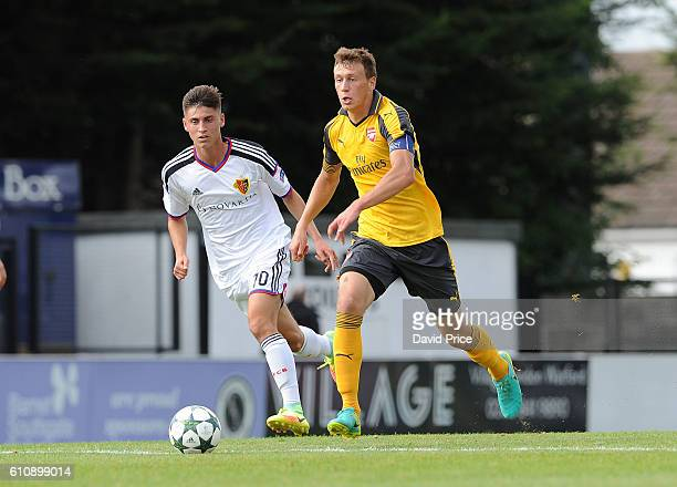 Krystian Bielik of Arsenal takes on Gezim Pepsi of Basel during the UEFA Champions League match between Arsenal FC and FC Basel 1893 at Meadow Park...