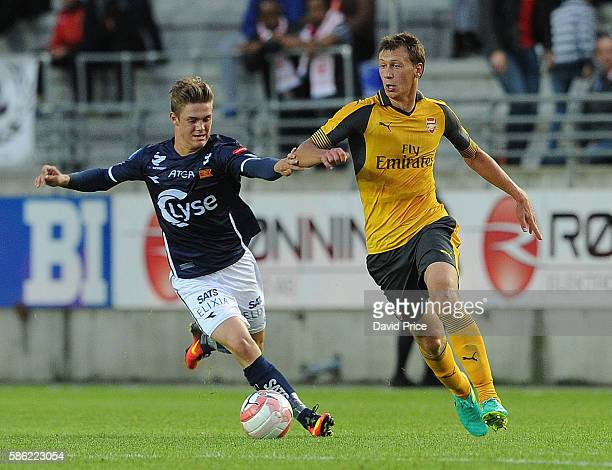 Krystian Bielik of Arsenal takes on Mathias Bringaker of Viking during the match between Viking FK and Arsenal at Viking Stadion on August 5 2016 in...