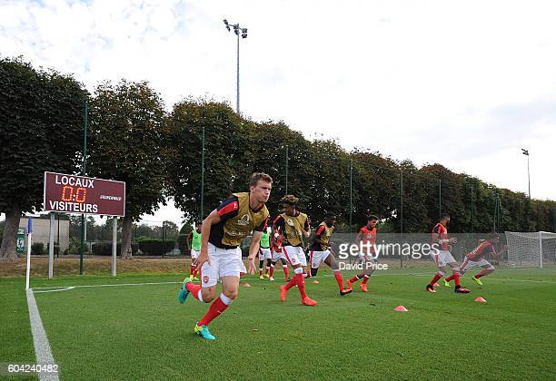 Krystian Bielik of Arsenal warms up before the UEFA Champions League match between Paris SaintGermain and Arsenal at Stade GeorgesLefevre on...
