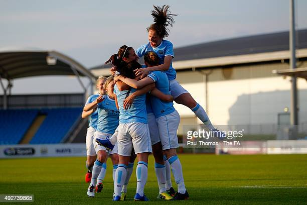 Krystle Johnston of Manchester City celebrates her goal with team mates during the FA WSL 1 match between Manchester City Women and Everton Ladies FC...