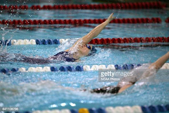 Krystle Satrum of Franklin Marshall and Meghan Faughnan of Williams race in the 200 yard backstroke final during the Division 3 Women's Swimming and...