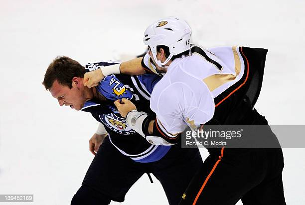 Krystofer Barch of the Florida Panthers fights with George Parros of the Anaheim Ducks during a NHL game at the BankAtlantic Center on February 19...