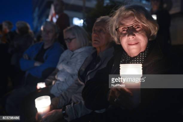 Krystyna ZachwatowiczWajda the wife of film director Andrzej Wajda during the antigovernment candlelit vigil in front of Krakow's District Court on...